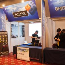 Our friends from AV Tokyo were also exhibiting and came fully prepared with projector, posters, buttons and stickers! .JP power!